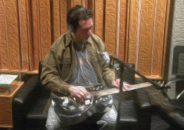 Film & TV composer Ben Zarai records a movie soundtrack, playing a dobro